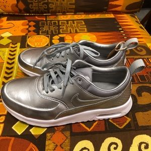 Nike silver shoes